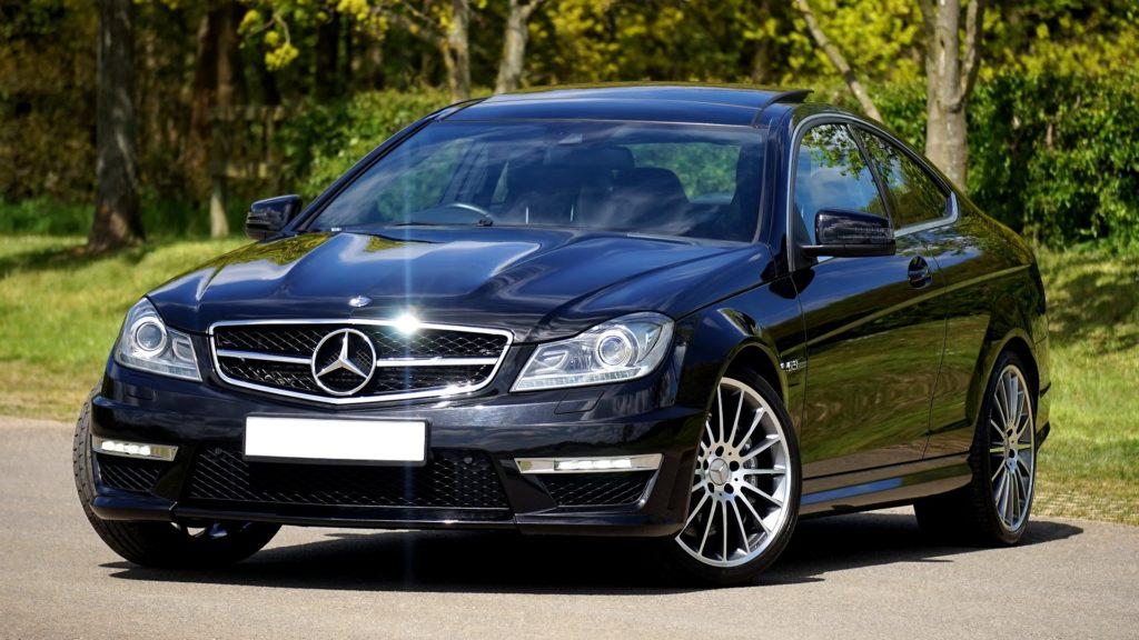 A black Mercedes saloon