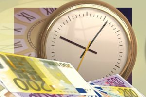 A clock and Euro notes