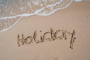 Holiday drawn on the sandy beach