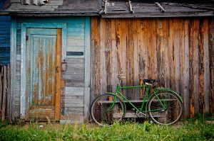 Pedal bike leaning against a shed