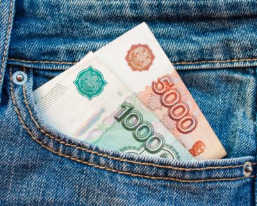foreign currency notes in a jeans pocket