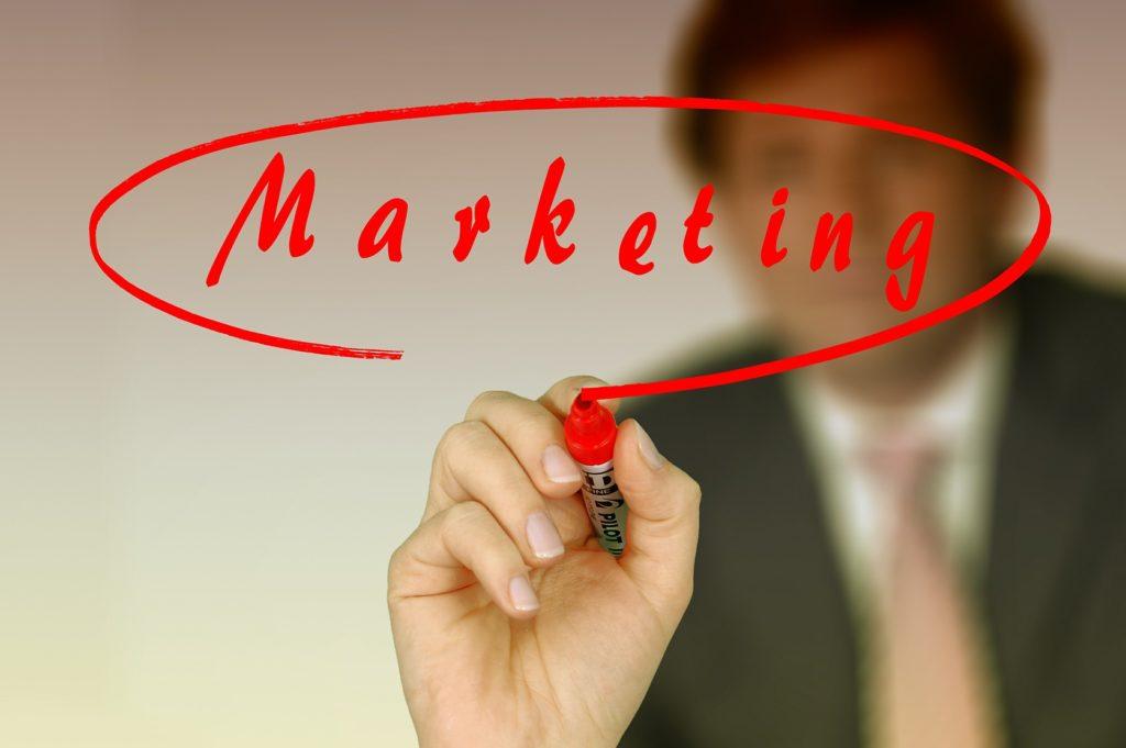 "A businessman writing ""marketing"""