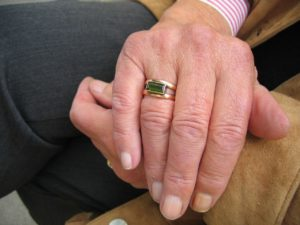 Pensioners hold hands