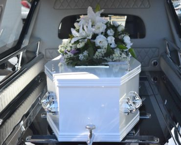 A coffin in a hearse on the way to a funeral