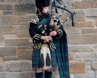 A bag piper in Scotland