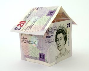 Mortgage concept: house made from £20 notes