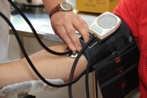 Taking a patients' blood pressure