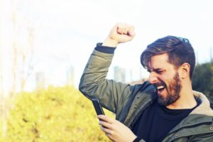 A happy man with his smartphone