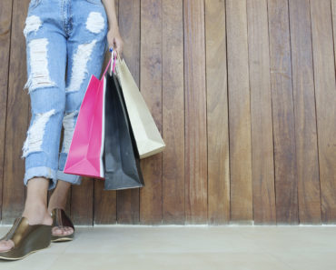 Closeup of woman holding shopping bags
