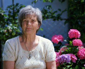 A pensioner in her garden
