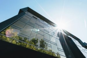 A modern office building shining in the sun
