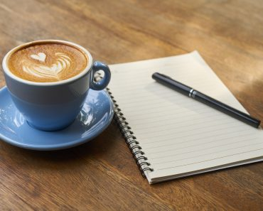 A cup of coffee and a notebook