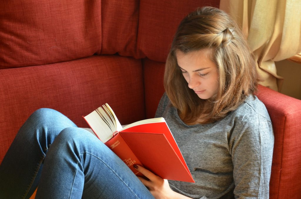 A female student reading a book