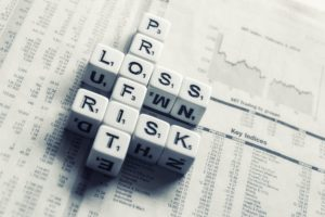 A business finance concept of profit, loss and risk