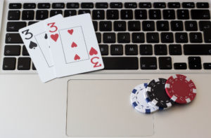 Playing online poker laptop concept
