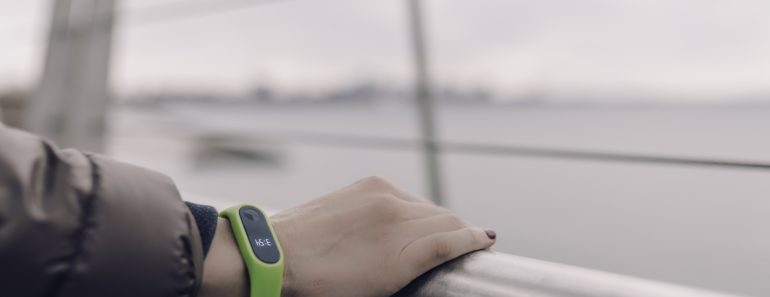 A green fitbit exercise tracker
