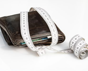 Measuring a wallet with a tape measure
