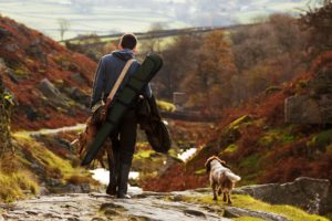 A hunter and and his dog