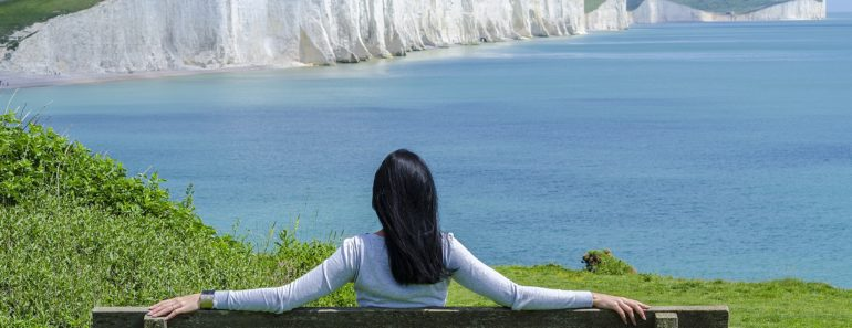 A woman enjoying a picturesque sea view