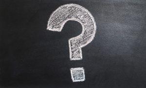 A question mark chalked onto a blackboard