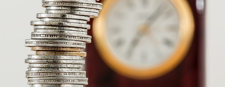 Coins and a clock in the background