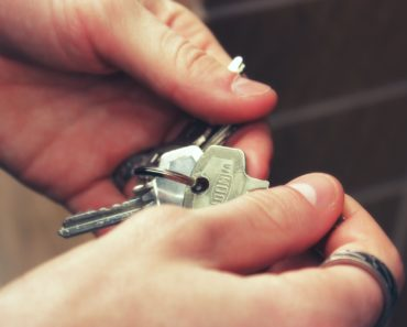 Holding keys to a house or apartment