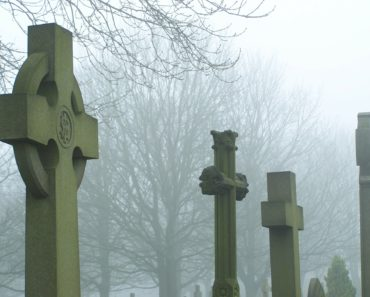 Tomb stones in a misty cemetery