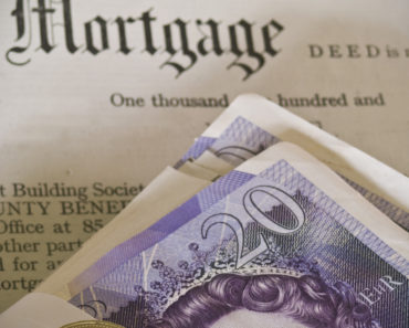 A Mortgage document and twenty pound notes