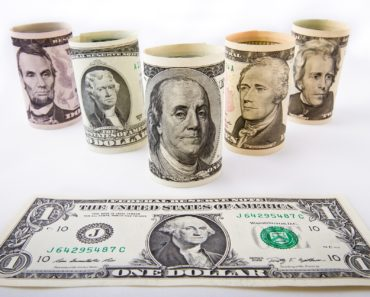 Dollar bills and mugs with US presidents painted on