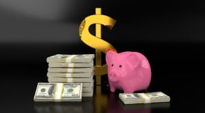 A piggy bank and Dollars