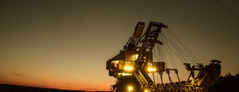 A mining excavator working in the dark