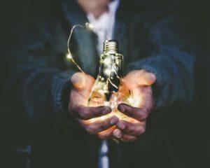 Inspirational moment, holding a light bulb