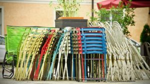 Stacked chairs at an outdoor event