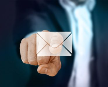 A businessman pointing at an email