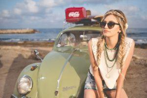 Wearing sunglasses sitting on a car bonnet