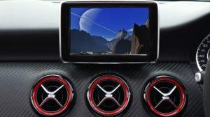 A car dashboard and sat nav screen