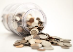 Cash falling out of a jar