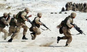 Soldiers running in the desert