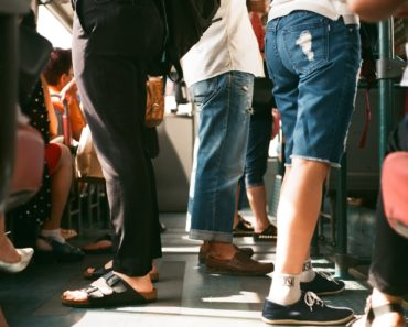 Commuters standing on a crowded train