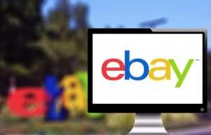 The ebay logo displayed on a laptop