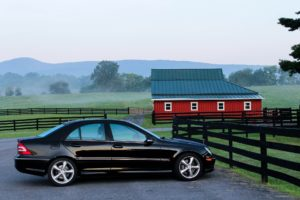A black Mercedes car in the countryside