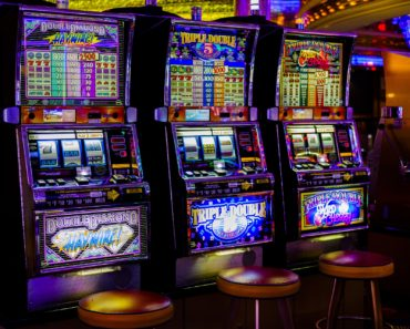Three slot machines in a casino