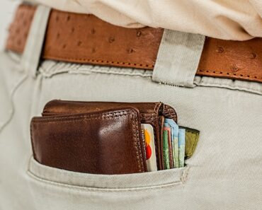 A bulging wallet in someones back pocket