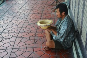 A beggar begging in the street