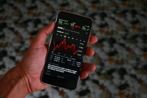 Falling share prices displayed on an iphone