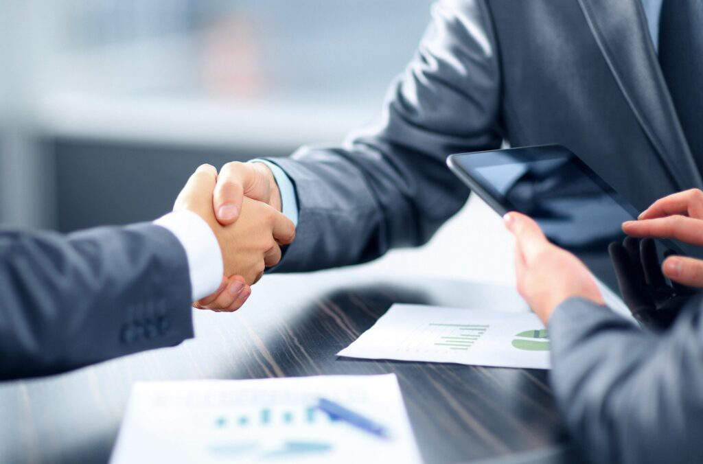 Shaking hands over a finance agreement