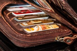 A wallet holding many credit cards