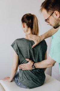 Examining a woman's back