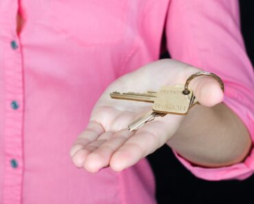 Holding a set of door keys