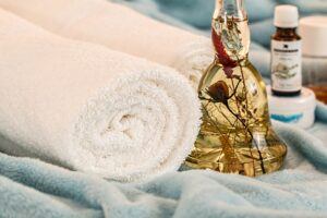 Massage therapy with towels and oils
